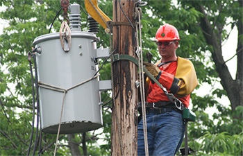 Professional Electrician Servicing a power pole