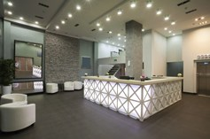 Office reception with custom lighting